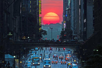 Sun on the horizon in an urban setting