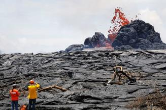 photo of a lava waste below a volcano